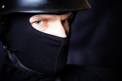 Man in helmet and mask staring at you
